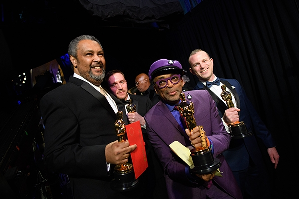 Spike Lee poses backstage with the Oscar® for adapted screenplay
