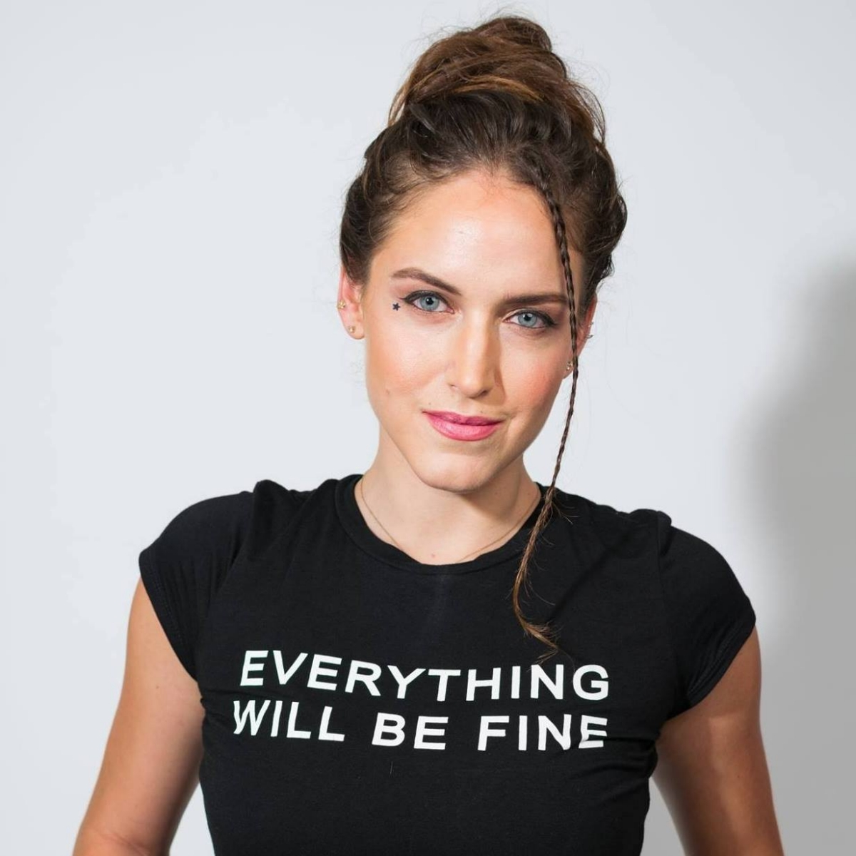 headshot Sophie LaBelle wearing black t-shirt that reads