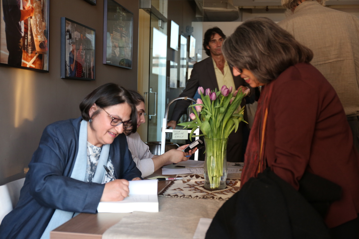 Dr. Ella Shohat signs copies of her book