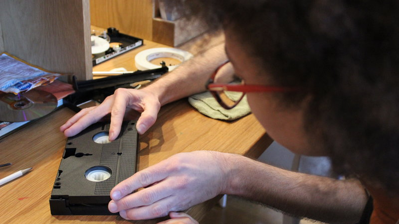 XFR Collective member Carmel Curtis (MIAP '15) working on a VHS tape. Photo credit: Lorena Ramirez-Lopez/XFR Collective.