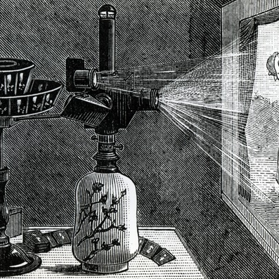 An engraving of a magic lantern setup, with an image of a mother and baby on the screen.