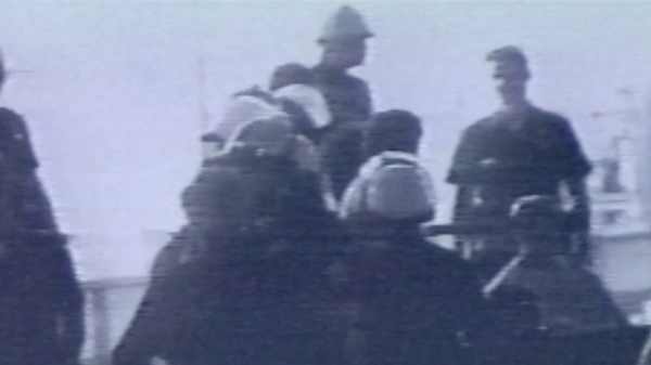 Screen capture of Portia Cobb'sshort film, showing a group of police officers wearing helmets
