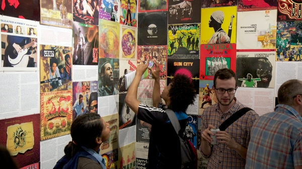 Inside Interference Archive: visitors looking at collection of flyers.