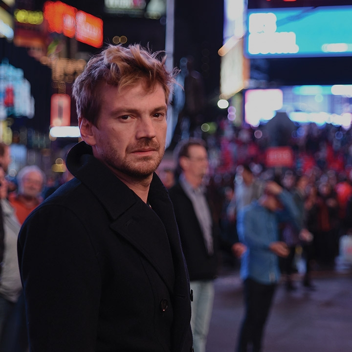 A still from Julia Solomonoff's third feature film, Nadie nos mira (Nobody's Watching). Nico (played by Guillermo Pfening) stands in the center of Times Square amidst a crowd of people.
