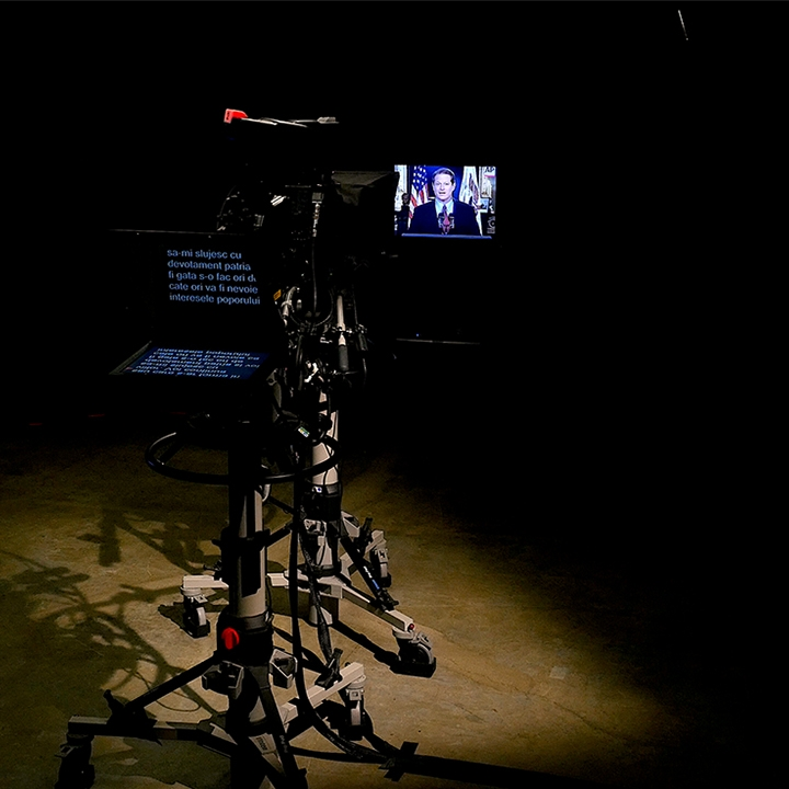Three screens, camera and teleprompter