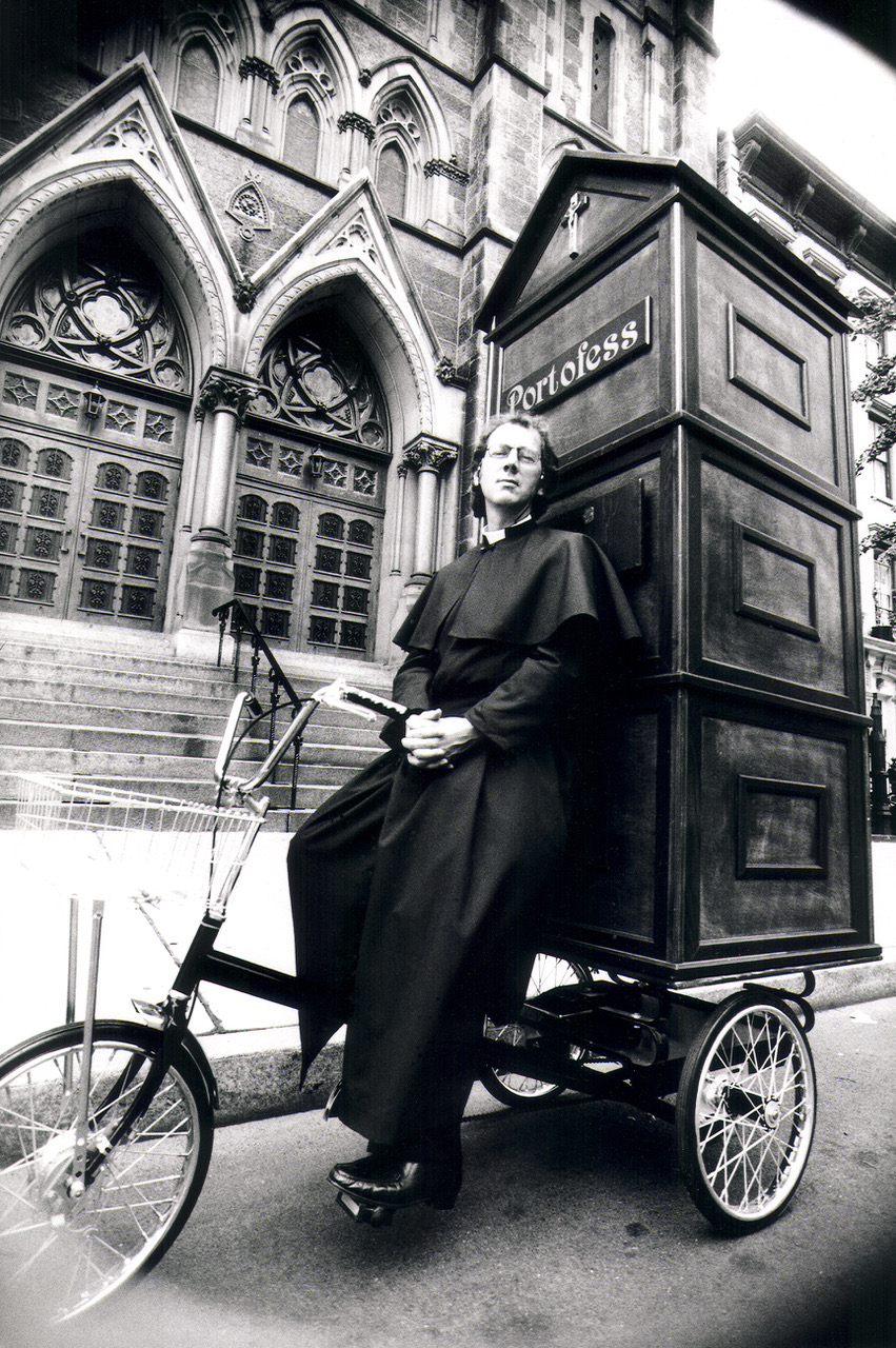 Joey Skaggs pedaling Portofess, his mobile confessional booth, on his way to the Democratic National Convention in 1992 to hear the confessions of politicians, courtesy of The Joey Skaggs Collection.