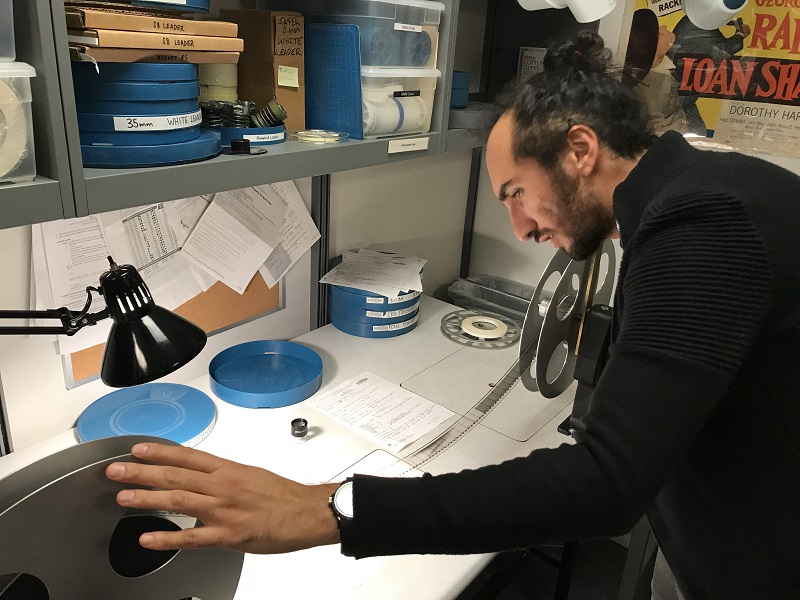 NYU MIAP student Shahed Dowlatshahi--winner of the Film Noir Foundation's 2018 Nancy Mysel Legacy Grant--inspecting film at NYU Libraries'  Barbara Goldsmith Preservation & Conservation Department. Photo credit: Michael Henry Grant (MIAP '15).