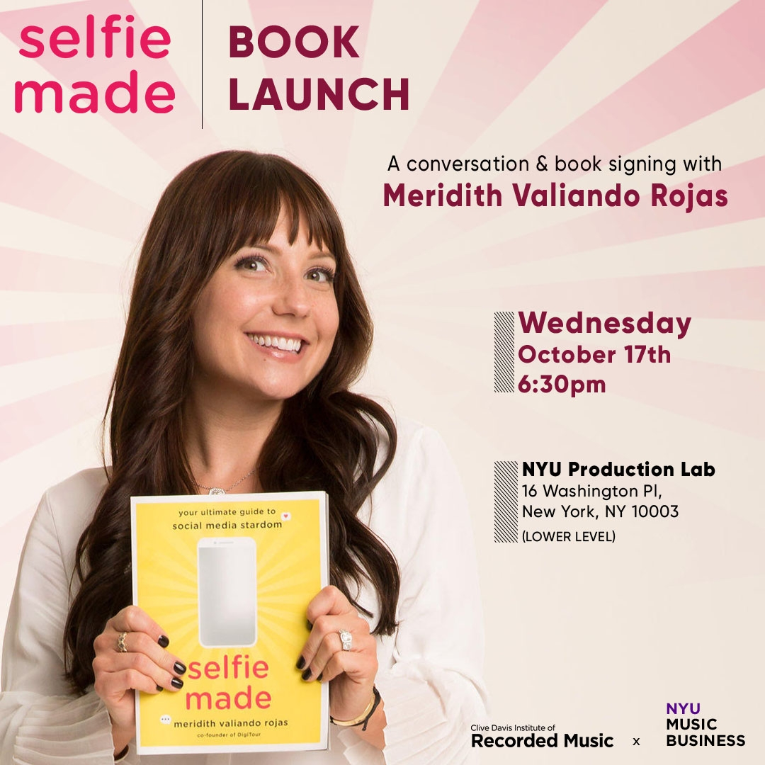 Author Meridith Valiando Rojas holding her new book titled Selfie Made