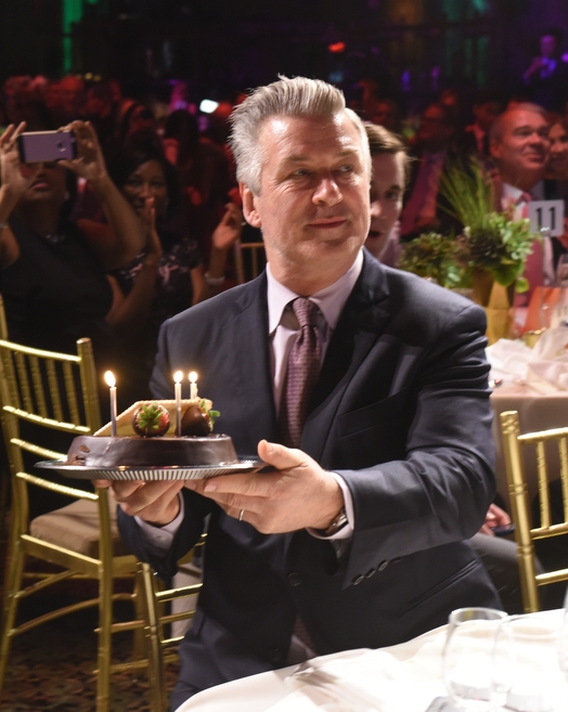 Alec Baldwin presented with a birthday cake while guests sang Happy Birthday