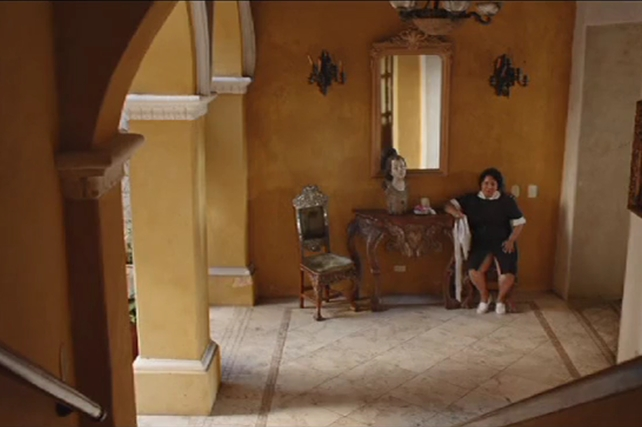 Film Still: Maid Sitting Alone In Hallway