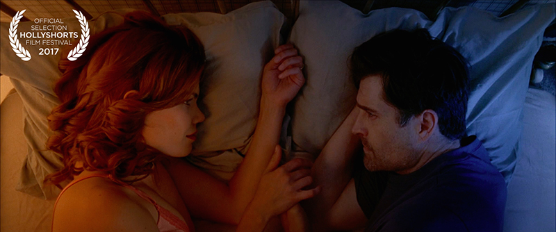 Film Still from Goodnight Eulogy, couple in bed looking at each other
