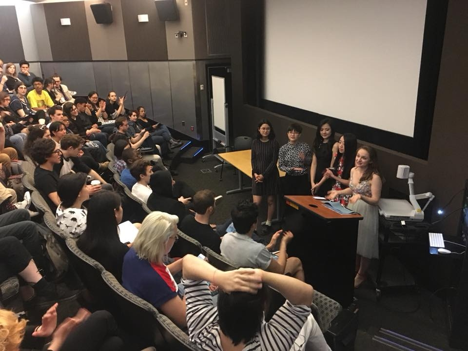 Image of students in SAL opening the showcase in room 006