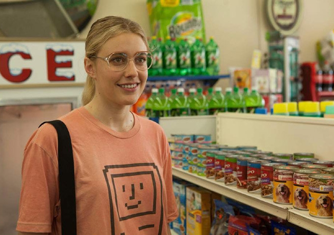 A film still of Wiener-Dog. Shown is a young woman in a grocery store.