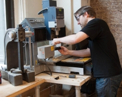a person demo'ing the 4-axis CNC mill