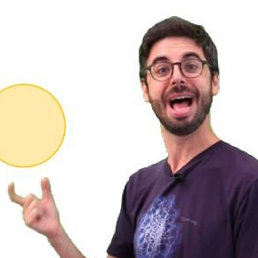A man smiling widely while balancing a yellow circle graphic
