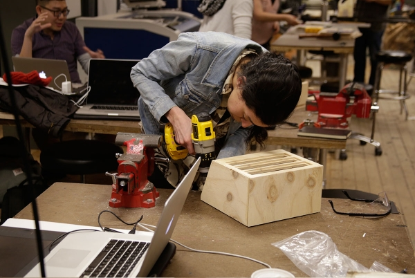 A woman with power tools working on her project.