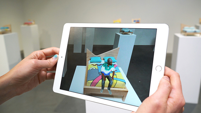 Screen showing augmented reality with live people that aren't really there