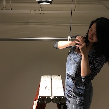 Picture of Yeseul working on a hanging sculpture