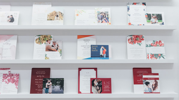 Wedding invitations on shelves in the Zola store