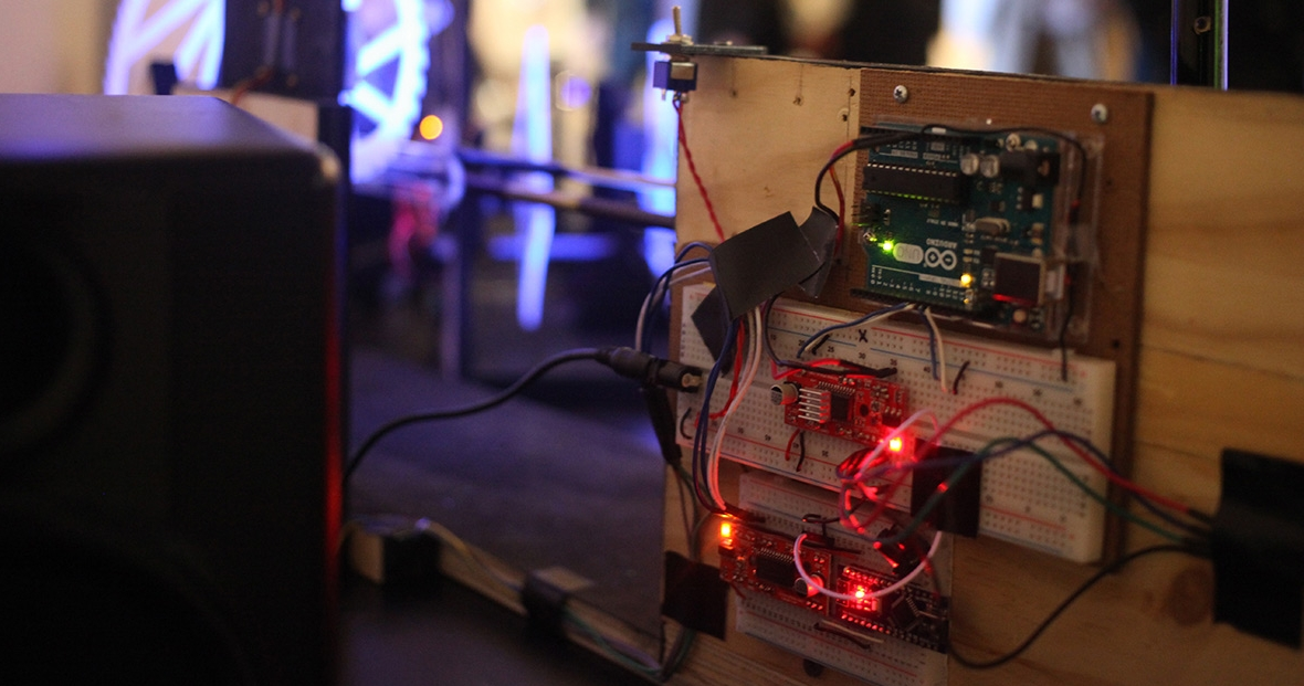 An Arduino board wired and lit up.