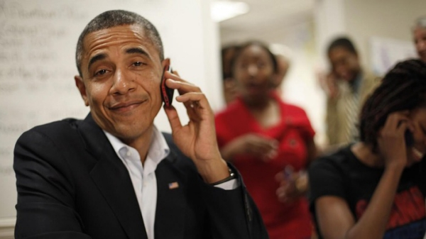 President Obama on a mobile phone smirking at the camera