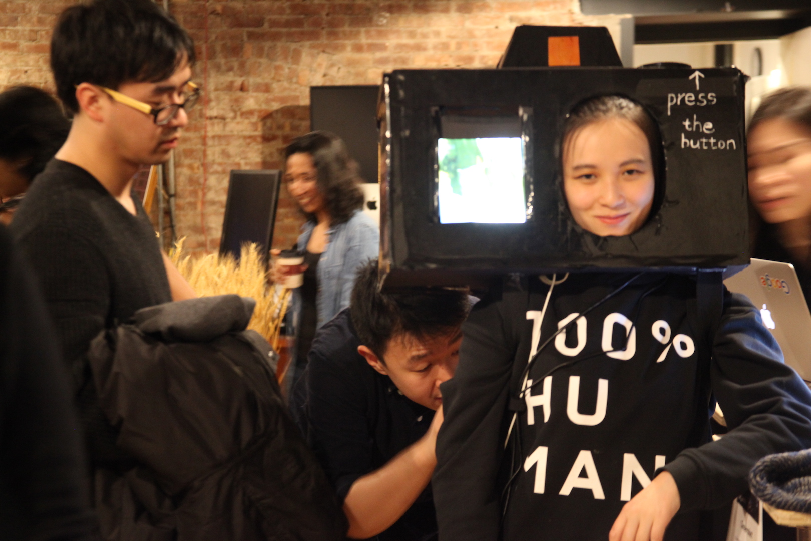 A woman wearing a gigantic looking camera on her head