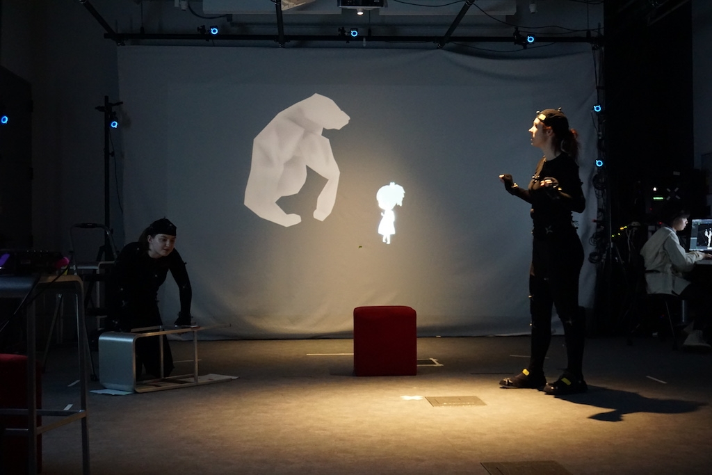 Photo of two people interacting with 3D projection; photo by Christina Hall