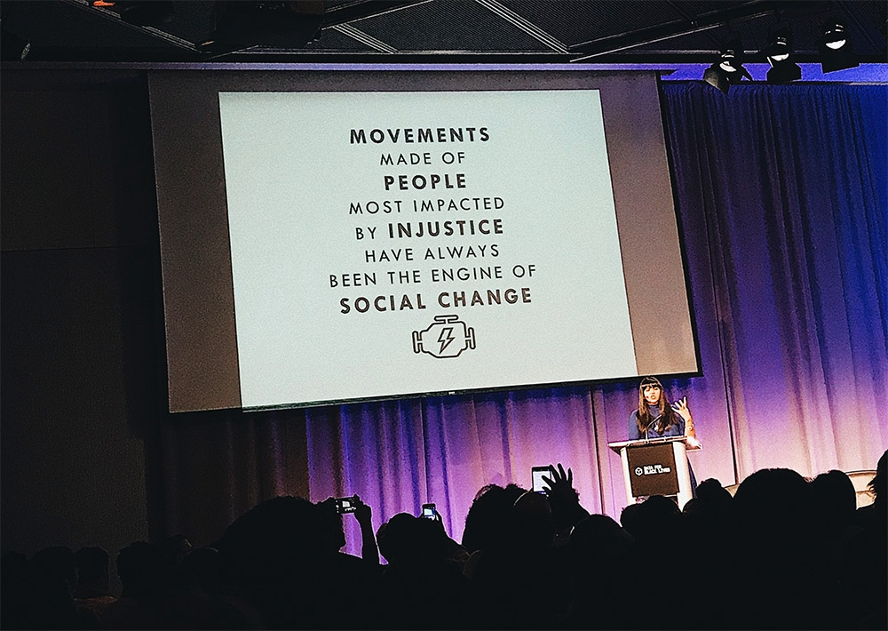 "projection on screen ""Movements made of people most impacted by injustice have always been the engine of social change"""