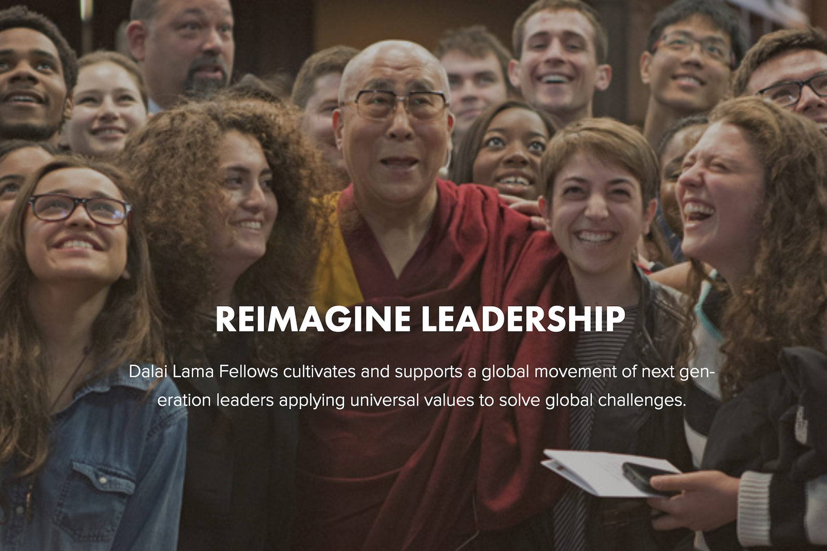 Image showing Dalai Lama surrounded by happy looking fellows; Reimagine Leadership: Dalai Lama Fellows cultivates and supports a global movement of next generation leaders applying universal values to solve global challenges