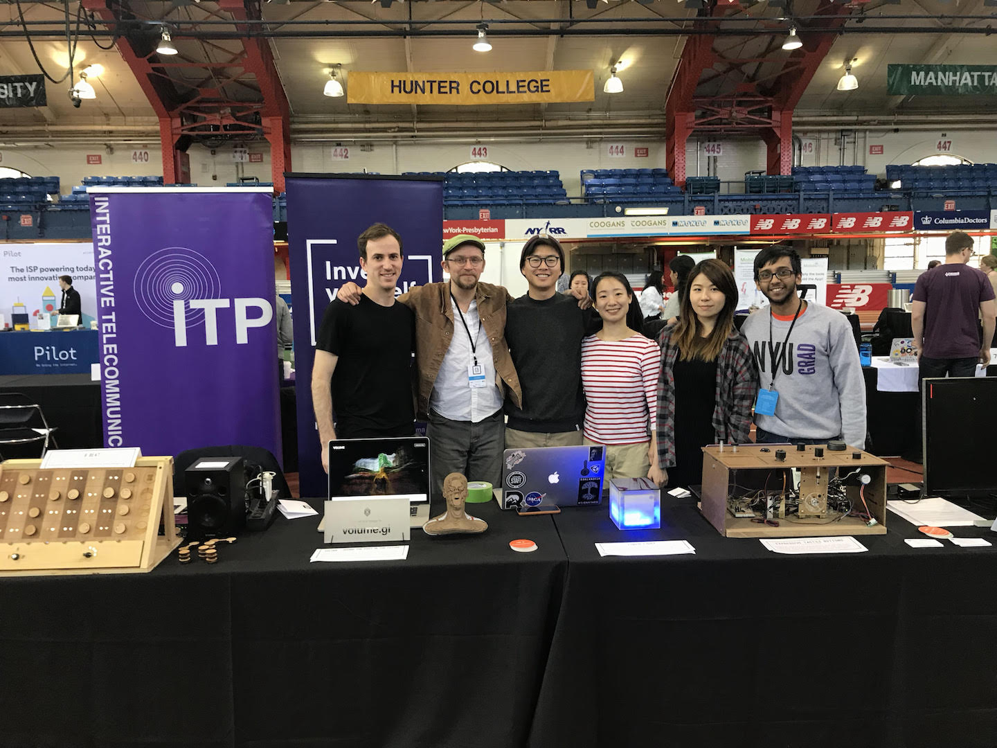 NYC CS Fair table booth with ITP students in front of physical computing projects