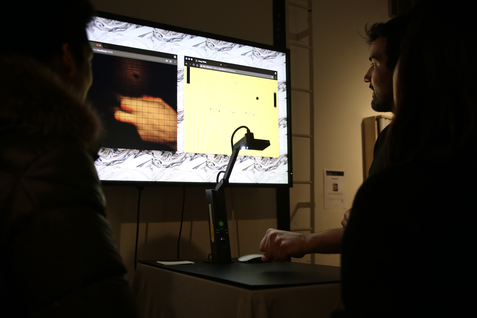 a person's hand that is projected onto a screen
