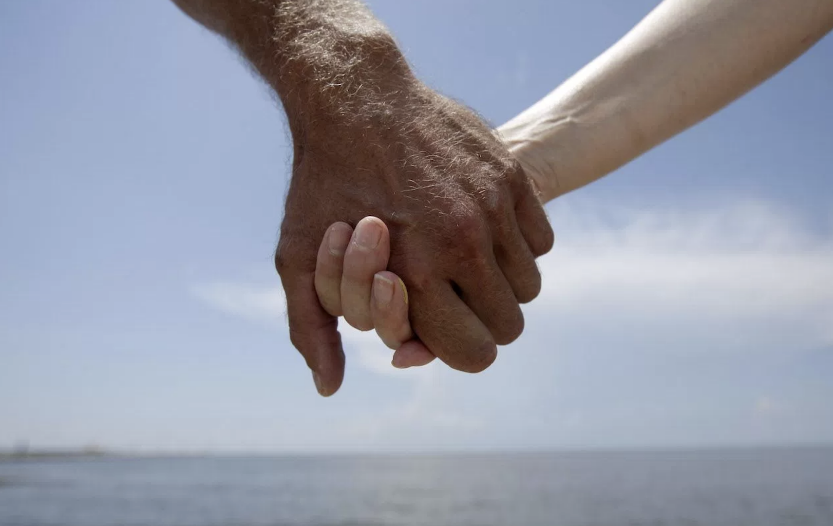 Hand holding, (AP Photo/Gregory Bull)