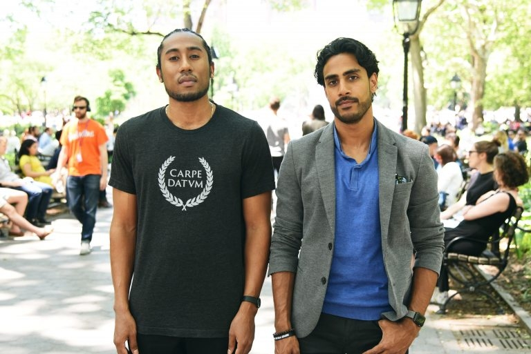 Jesal Trivedi standing in Washington Square Park with his partner from Aduri