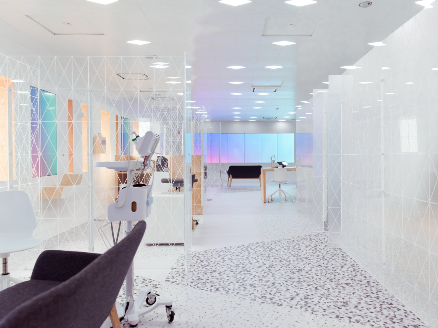 Image of a futuristic-looking lab with white walls and colored screens