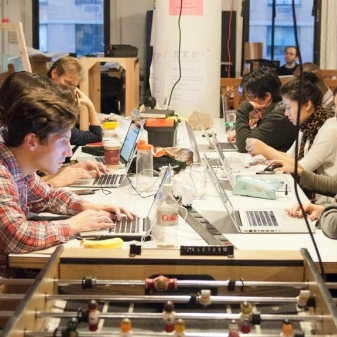 Image of students working at desks.