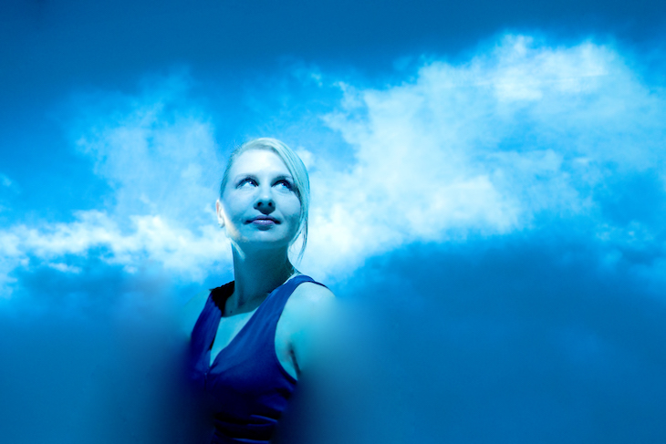 Maja Petric in a blue room, surrounded by what looks like clouds