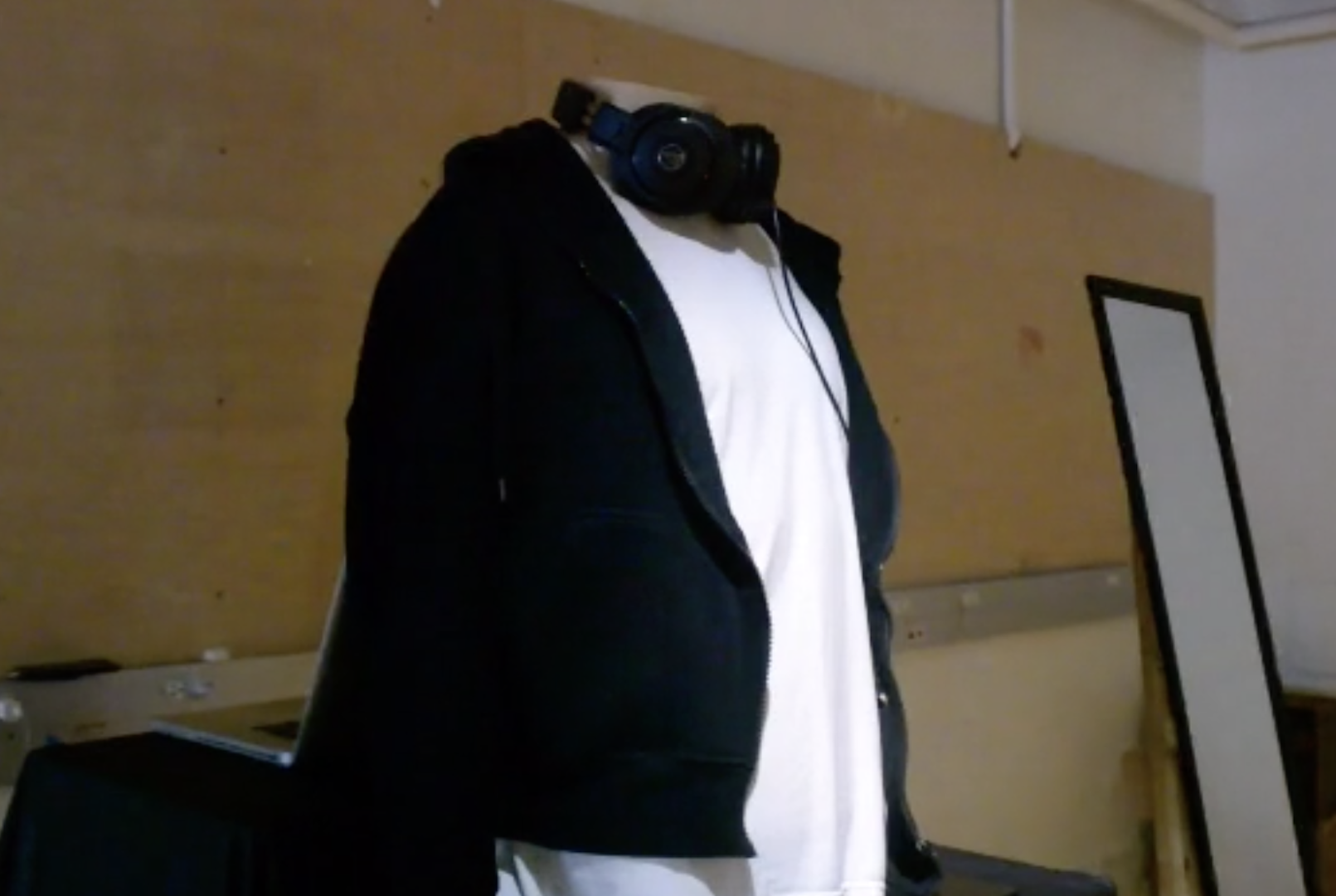 Misunderstood Project of a hoodie on a mannequin with a pair of headphones around the neck