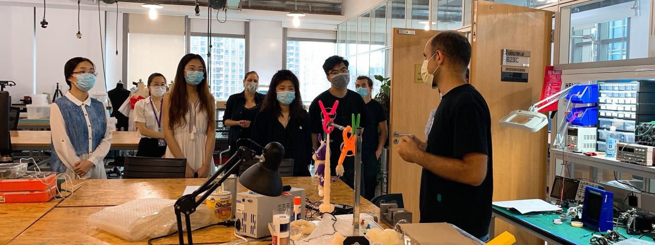 a group of students wearing masks in a maker space lab