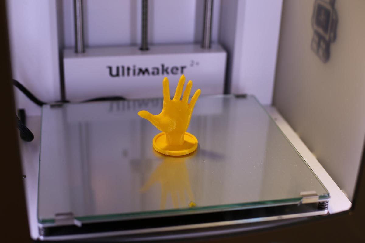 the completed hand from the 3D printer