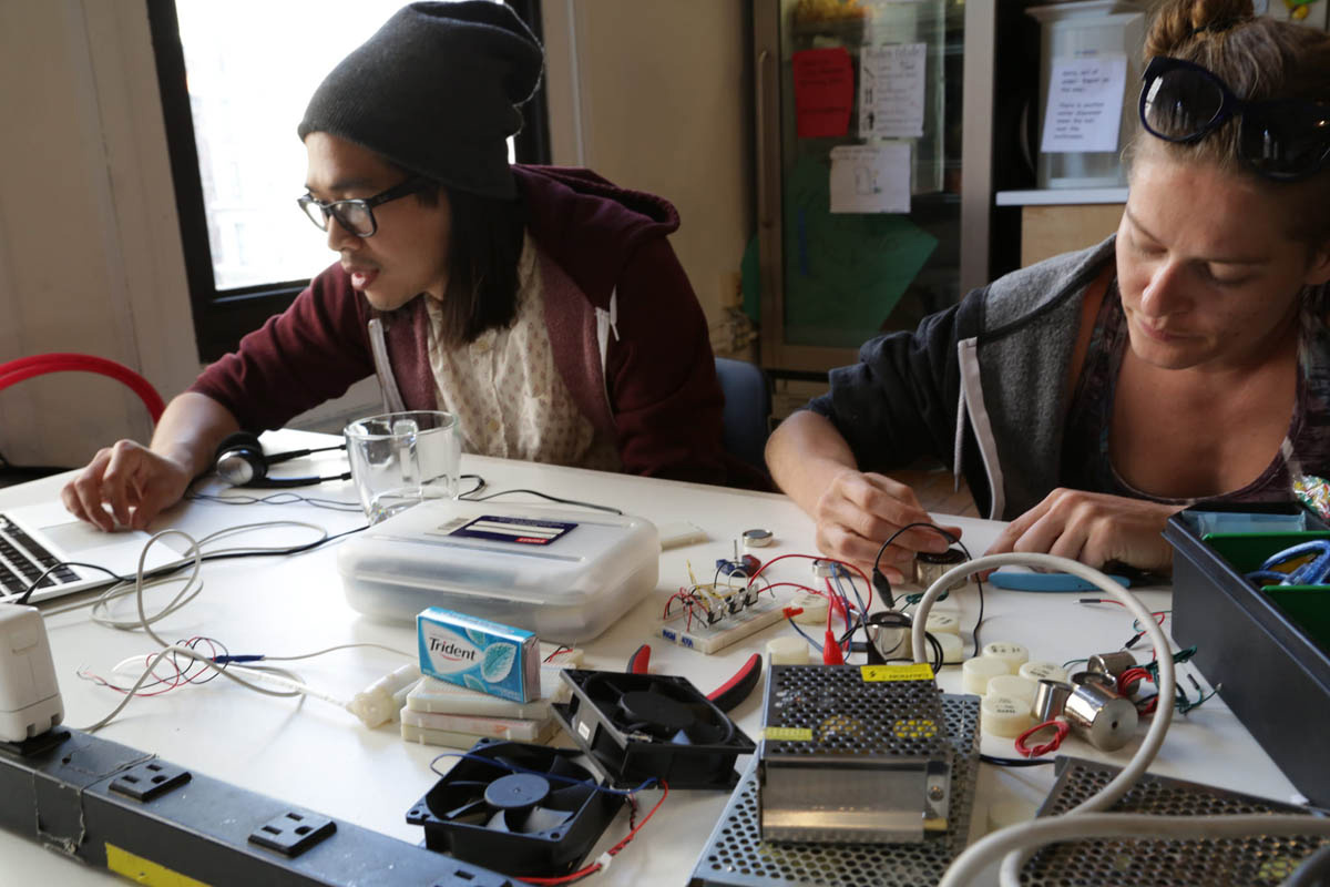 2 people working with physical computing