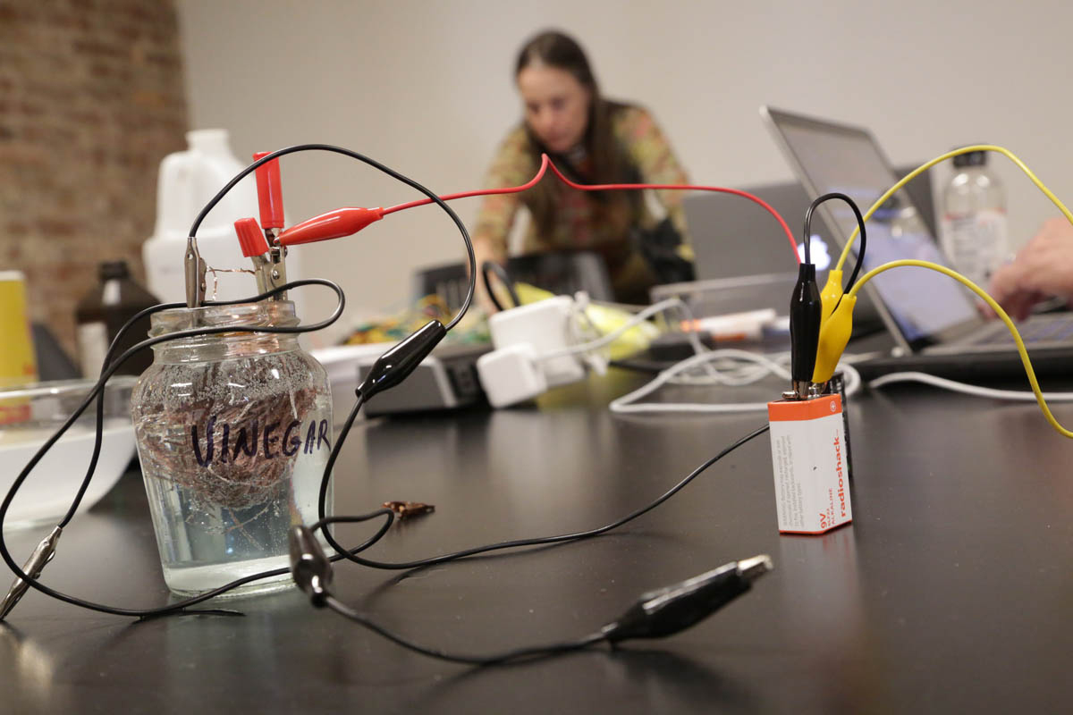 a battery, and wires hooked up to a copper ball immersed in liquid