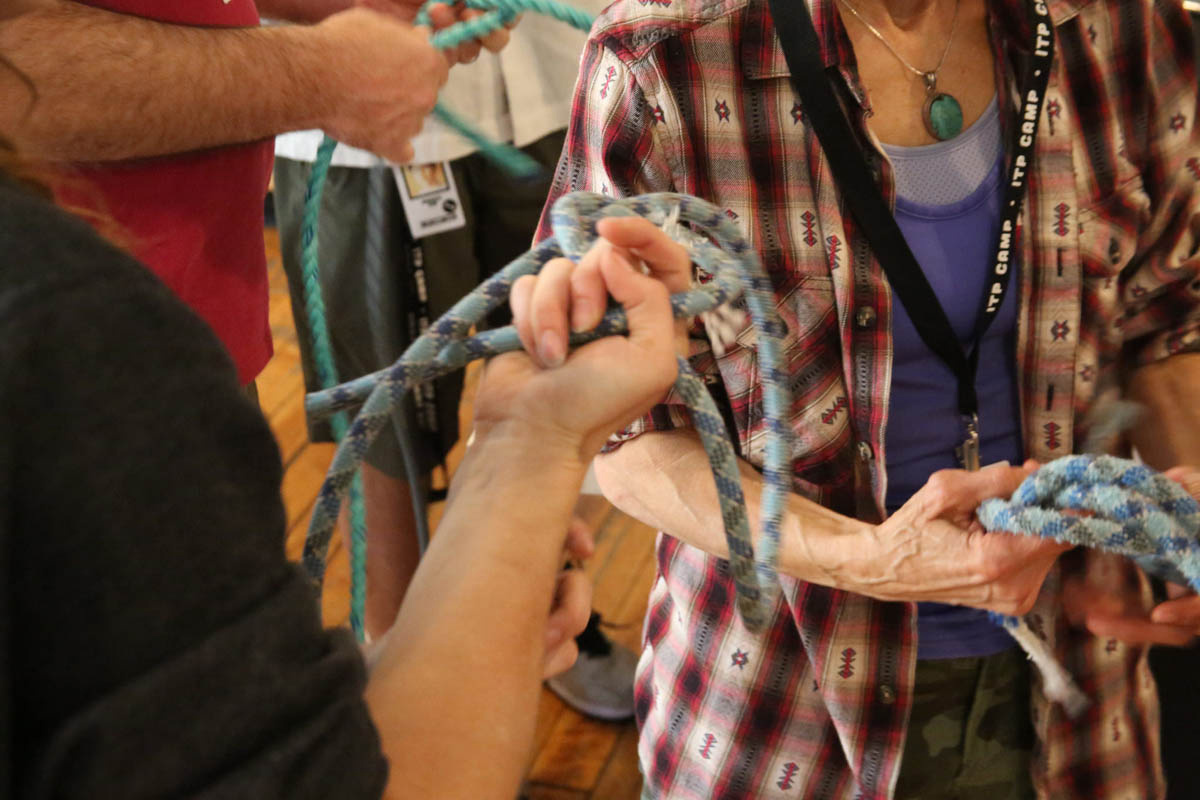 hands holding and tying climbing ropes