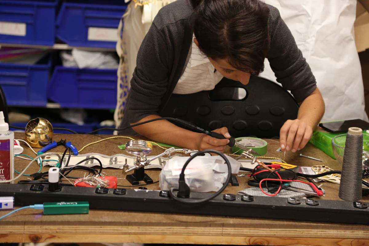 a woman soldering
