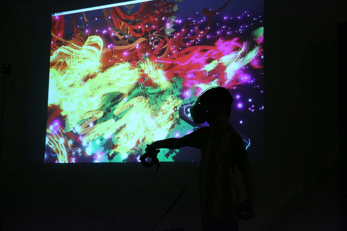 a silhouette of a person wearing VR goggles with a colorful pattern displayed