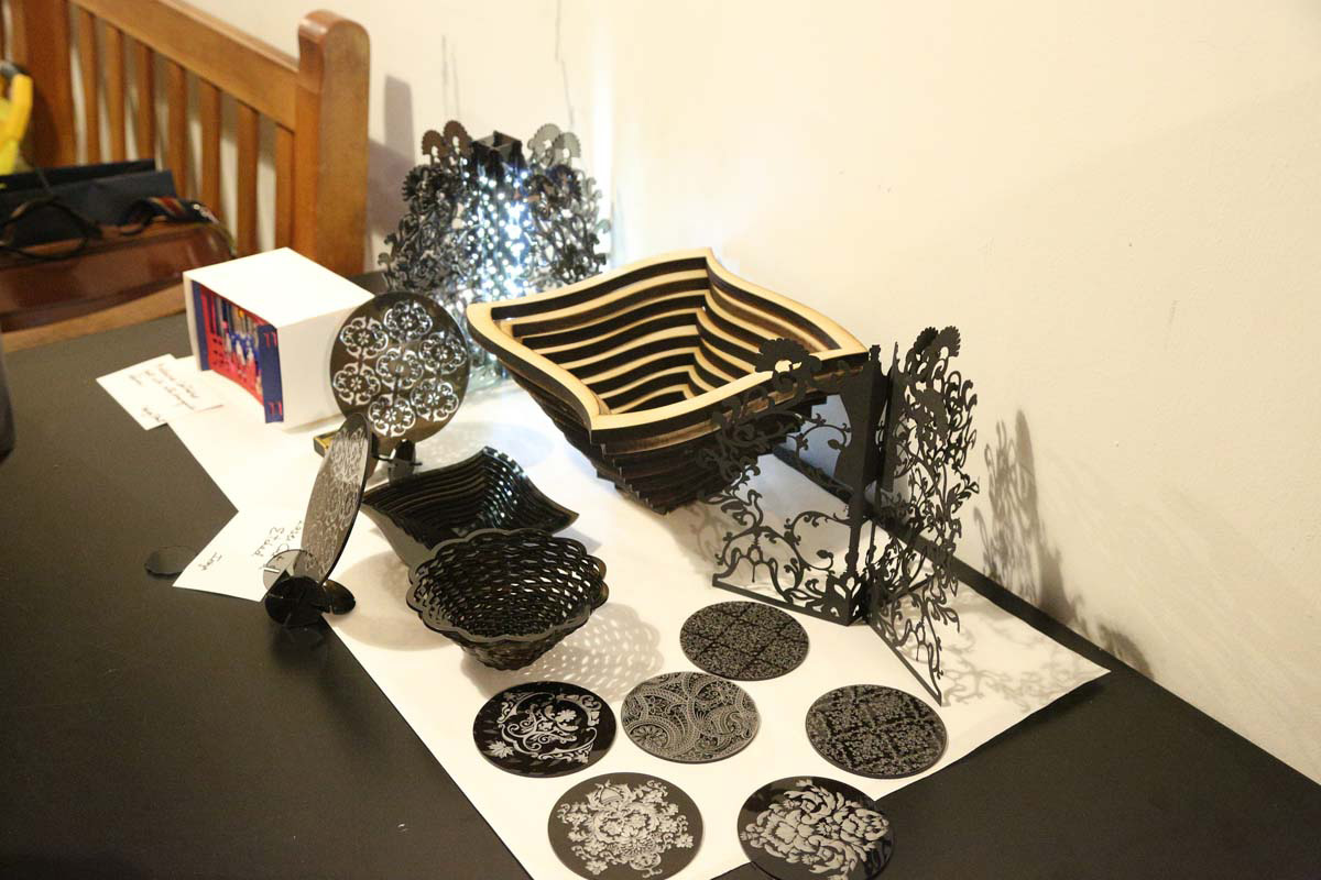 a display of intricately detailed bowls and designs that were laser cut