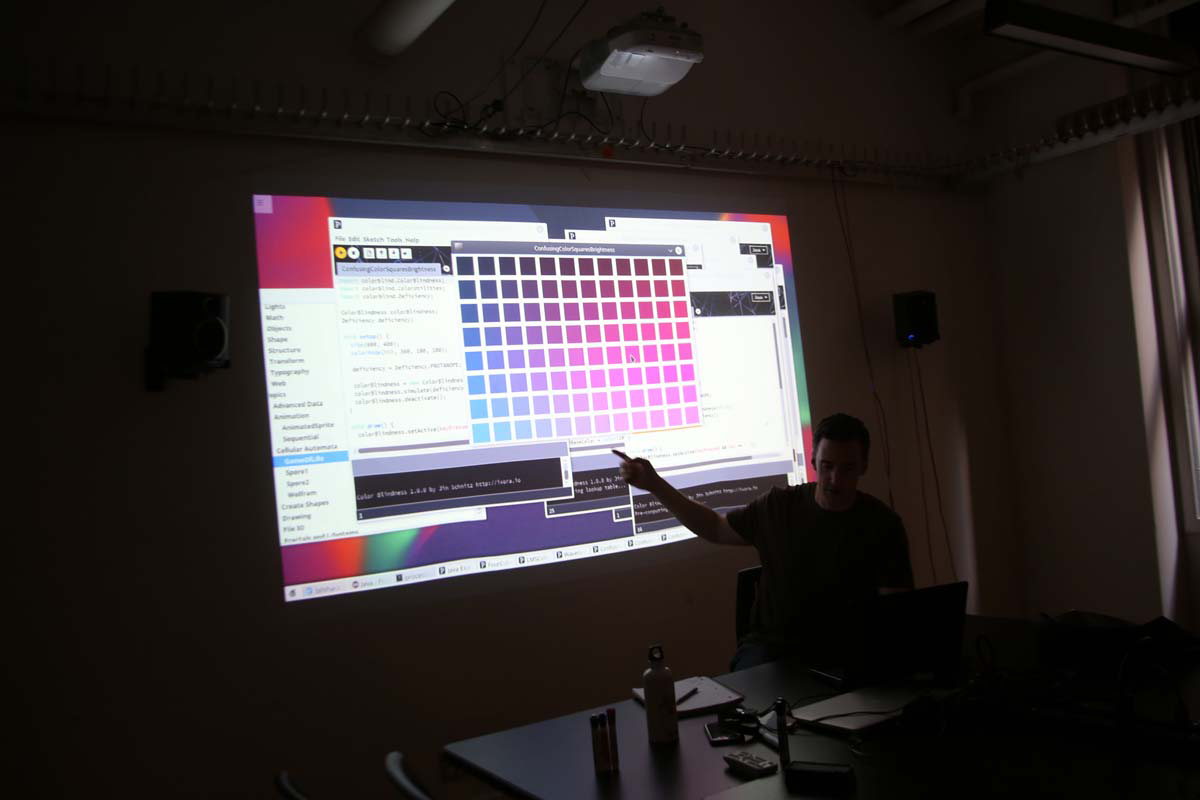 a lecture showing a color palette on screen