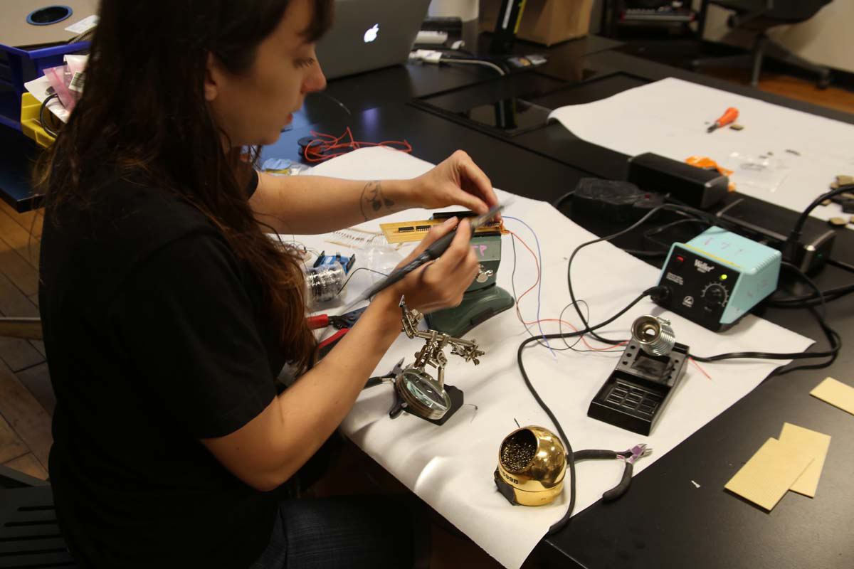 a person soldering
