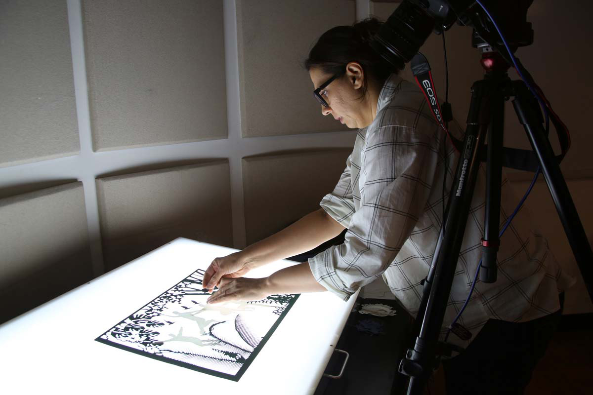 a person working on an animation with a light board