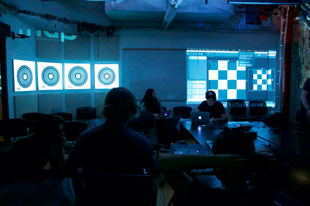 a darkened classroom with projections of circles and grids