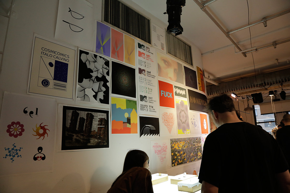 A wall full of colorful graphic design posters